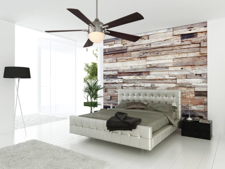 A sleek, contemporary bedroom complete with different textiles and a modern ceiling fan